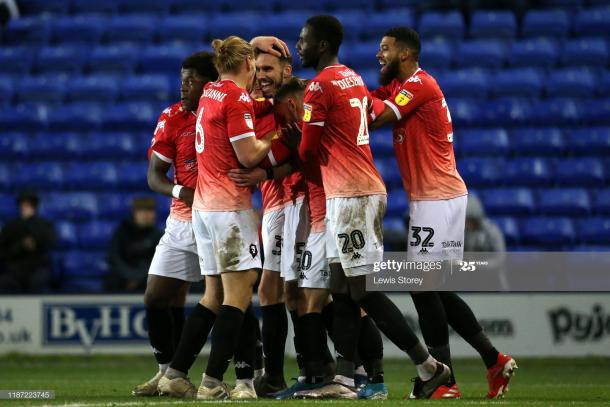 BIRKENHEAD, ENGLAND - NOVEMBER 12: Liam Hogan of Salford City celebrates scoring his sides second goal during the Leasing.com Trophy Northern Group C match between Tranmere Rovers and Salford City at Prenton Park on November 12, 2019 in Birkenhead, England. (Photo by Lewis Storey/Getty Images)