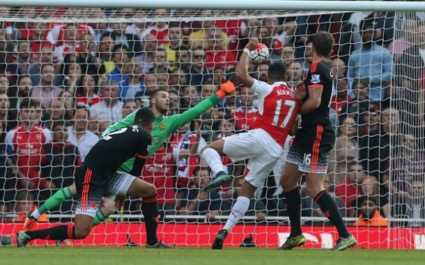Alexis Sanchez scoring Arsenal's third goal in the 3-0 against Manchester United in October