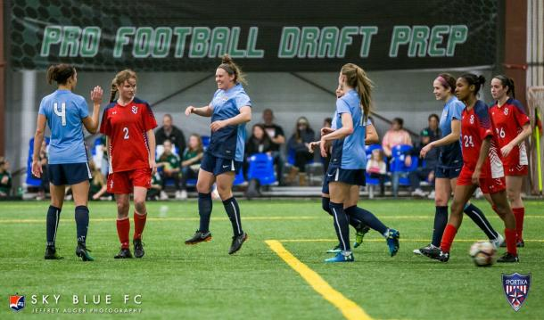 McCaskill and Lloyd celebrate a McCaskill goal against St. John's University l Photo: Jeffrey Auger/Sky Blue FC
