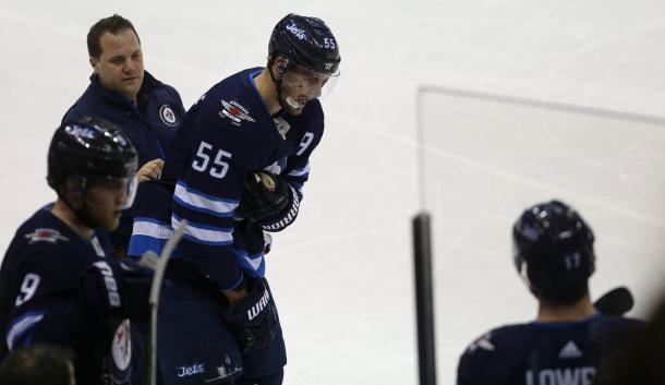 Mark Scheifele goes off with an upper body injury, decreasing the Jet's firepower. (Photo: Winnipeg Sun)