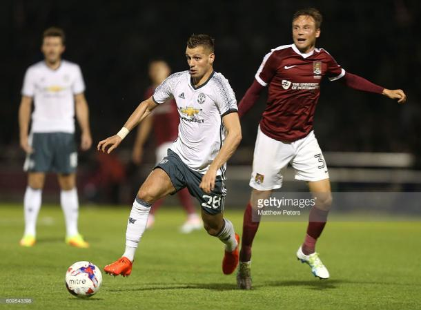 Morgan Schneiderlin in action during the EFL Cup Third Round match between Northampton Town and Manchester United. | Photo: Matthew Peters/Man Utd via Getty Images
