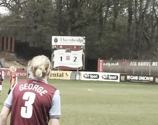 Hannah George checking the score