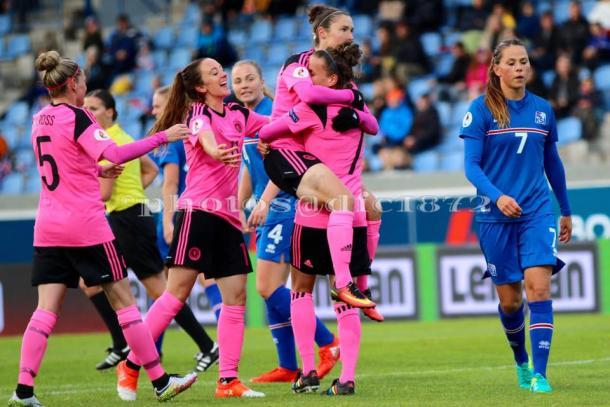 Scotland celebrates Jane Ross' winning penalty Photo: Tommy Hughes