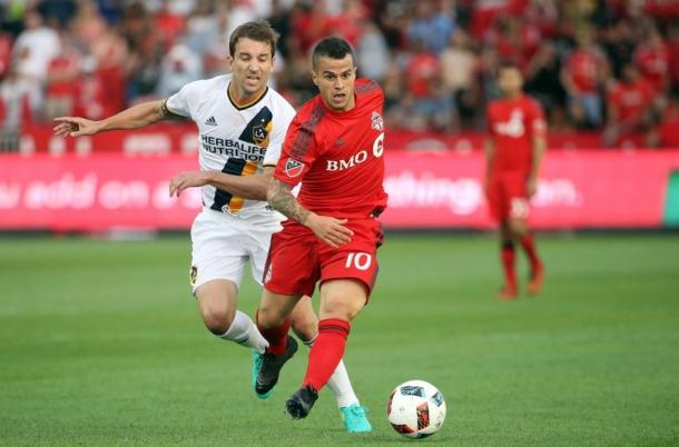 Red's Sebastian Giovinco (Center) running with the ball against the LA Galaxy on Saturday at BMO Field. Photo provided by USA TODAY Sports.