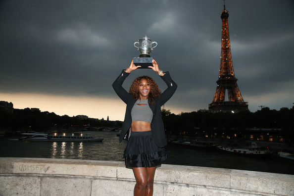 Serena Williams poses with the French Open trophy on the Pont Bir Hakeim, in front of the Eiffel Tower in Paris. Williams beat Maria Sharapova in 2 sets. ( Source: PacificCoastNews.com)