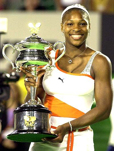Williams posing with her first Australian Open title in 2003, completing the Career Grand Slam in the process (Source: Pinterest)