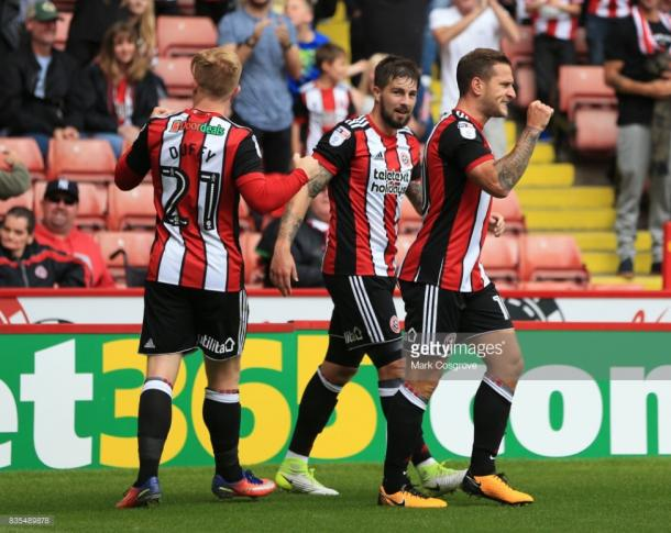 Billy Sharp (right) celebrates his goal against Barnsley | Photo: Getty/ Mark Cosgrove