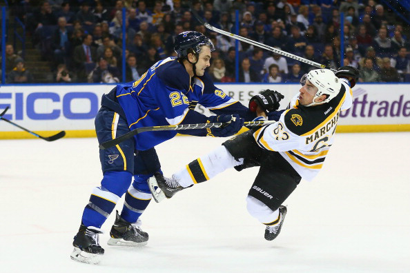 Kevin Shattenkirk #22 of the St. Louis Blues pushes Brad Marchand #63 of the Boston Bruins to the ice at the Scottrade Center on February 6, 2014 in St. Louis, Missouri. (Photo by Dilip Vishwanat/Getty Images)