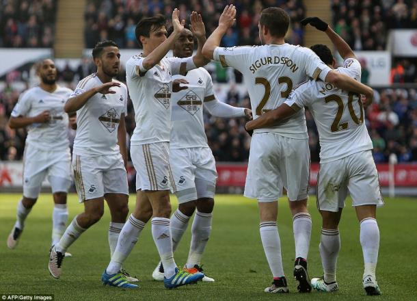 Swansea celebrate their goal (photo: Getty Images)