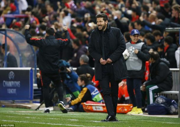 Simeone, who got his tactics spot on, manages a smile as his fans go wild (photo: Reuters)