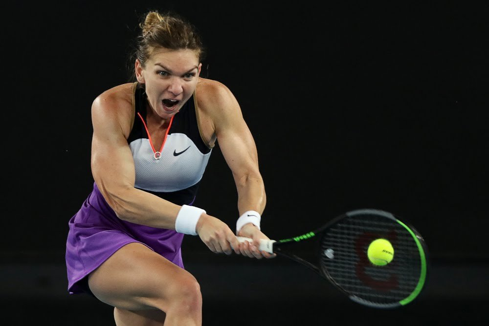 Halep reaches for a backhand in her comeback victory/Photo: AFP