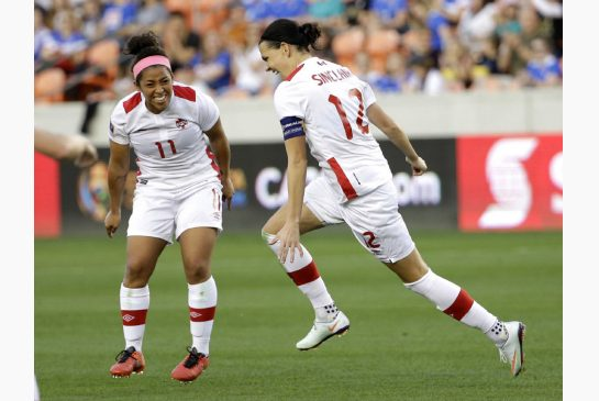 Desiree Scott (Left) and Christine Sinclair (Center) celebrating Sinclair's seconds goal of the match on Friday against Costa Rica at BBVA Compass Stadium. Photo provided by David J. Phillip-Associated Press Photo.