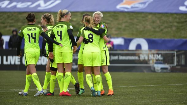 Rapinoe and teammates celebrate her converted penalty shot l source: nwslsoccer.com