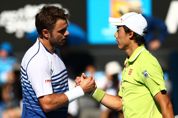 Wawrinka and Nishikori shaking hands at the net following their quarterfinal encounter at the Australian Open in 2015 (Photo by Cameron Spencer / Getty Images)
