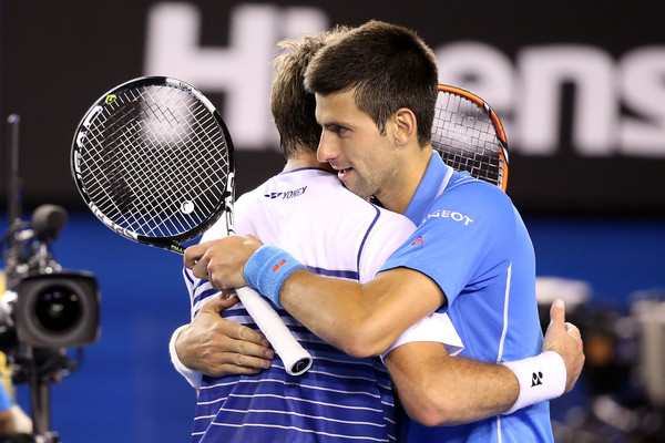 Wawrinka and Djokovic embrace at the net following their semifinal encounter at the Australian Open last year (Photo by Michael Dodge / Getty Images)