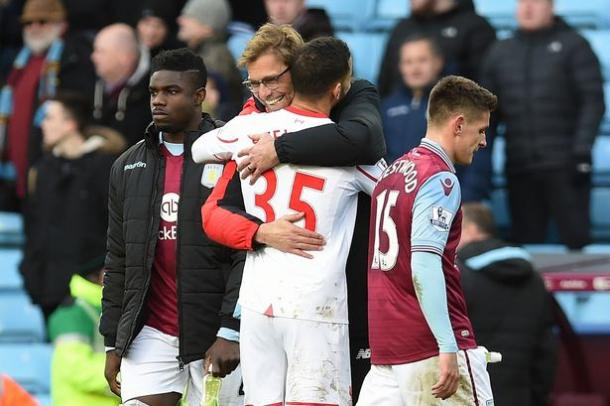 A delighted Klopp greets Stewart after making his league debut at Villa. (Picture: Getty Images)