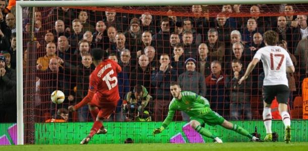 Daniel Sturridge scores Liverpool's first from the penalty spot as the United players can only watch on | Photo: Getty Images
