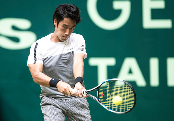 Sugita came up with some good shots and defence but was ultimately no match for Federer (Photo by Lars Baron / Bongarts)