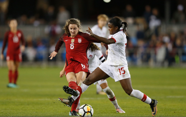 Sullivan (6) battles with Canada's Nichelle Prince (15) in the USWNT's final game of 2017; a 3-1 victory. | Photo: Lachlan Cunningham - Getty Images