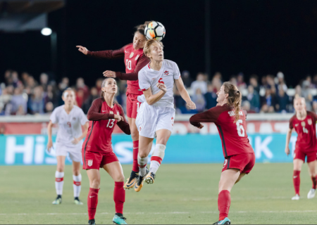 USA midfielder Andi Sullivan (6) and Canada midfielder Rebecca Quinn (5) will be playing for the same team after they were both selected in the first three picks by the Washington Spirit. | Photo: David Madison - Getty Images