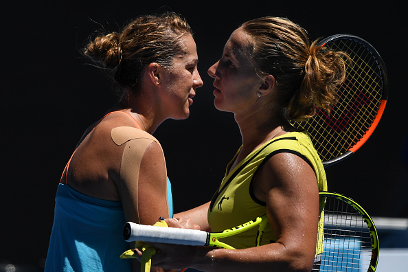 The compatriots embrace at the net (Photo by Greg Wood / Getty Images)
