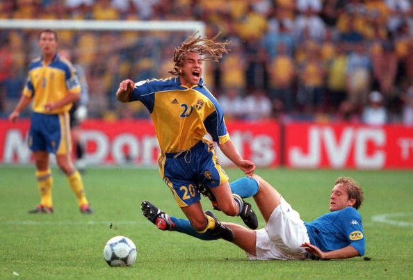 Massimo Ambrossini tackles Henrik Larsson at Euro 2000 | Photo: Popperfoto/Getty
