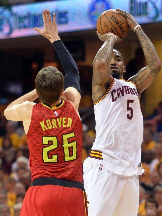 Cleveland Cavaliers guard J.R. Smith (5) sets up to shoot a three-point shot over Atlanta Hawks guard Kyle Korver (26) Photo: Ken Blaze-USA TODAY Sports)