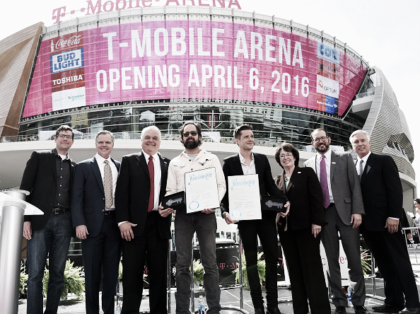 LAS VEGAS, NEVADA - APRIL 06: (L-R) T-Mobile Chief Marketing Officer Andrew Sherrard, MGM Resorts International Chairman and CEO Jim Murren, Clark County Commission Chairman Steve Sisolak, drummer Ronnie Vannucci Jr. and frontman Brandon Flowers of The Killers, Clark County Commissioner Mary Beth Scow, AEG President and CEO Dan Beckerman and President and CEO of Toshiba Global Commerce Solutions Scott Maccabe attend the T-Mobile Arena grand opening news conference on the Las Vegas Strip on April 6, 2016 in Las Vegas, Nevada. (Photo by Ethan Miller/Getty Images for MGM Resorts International)