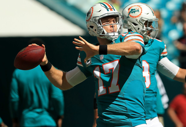Ryan Tannehill has to be taken care of by the defensive line, or he could hurt the Jets in the air. Credit: Mike Ehrmann/Getty Images North America