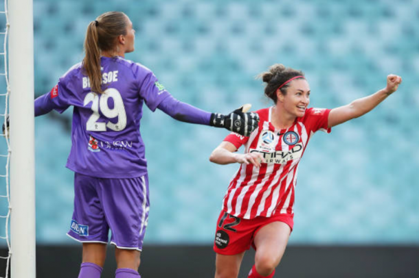Melbourne City's Jodie Taylor celebrates after scoring a goal to take her team ahead 2-0 while Sydney goalkeeper Aubrey Bledsoe looks at her defense in frustration. | Photo: Matt King - Getty Images