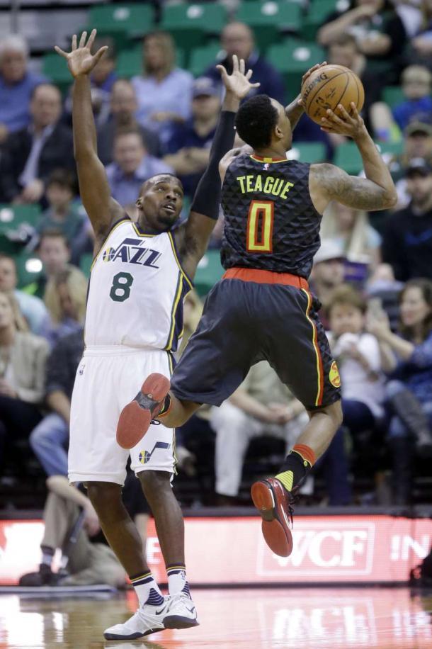 Utah's Shelvin Mack defends a shot by his former teammate, Jeff Teague. | Associated Press