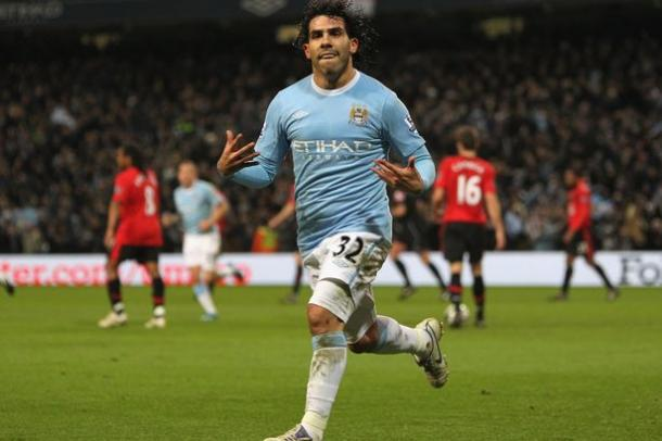 Tevez reels away in celebration after scoring against United for City | Photo: dailymail.co.uk