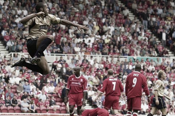 Thierry Henry jumps highest in celebration after opening the scoring in Arsenal's 4-0 rout of Middlesbrough to start the 2001-02 season