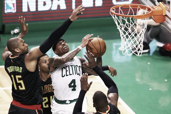 Isaiah Thomas (4) drives to the basket against three members of the Atlanta Hawks during the second quarter. (Source: Maddie Meyer/Getty Images North America)