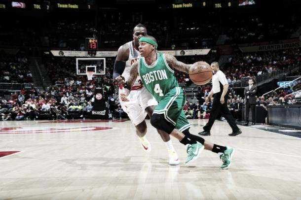Isaiah Thomas looks to make a shot to increase the Celtics' lead.   Scott Cunningham