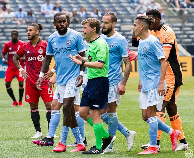Referee David Gantar is surrounded by NYCFC players after controversially ruling out the Boys In Blue's second goal/Photo: The NYCFC Nation