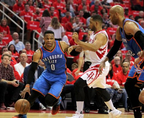 Oklahoma City Thunder guard Russell Westbrook (0) drives to the rim past Houston Rockets guard Eric Gordon (10). Photo by: Erik Williams-USA TODAY Sports