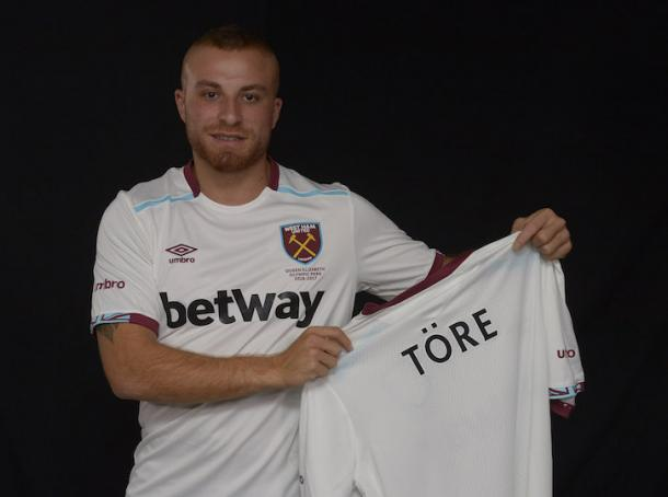 Above: Gokan Tore been unveiled as a West Ham player | Photo: whufc.com