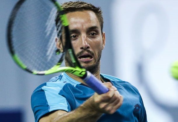 Photo Source: Yifan Ding/Getty Images-Viktor Troicki hits forehand return winner.