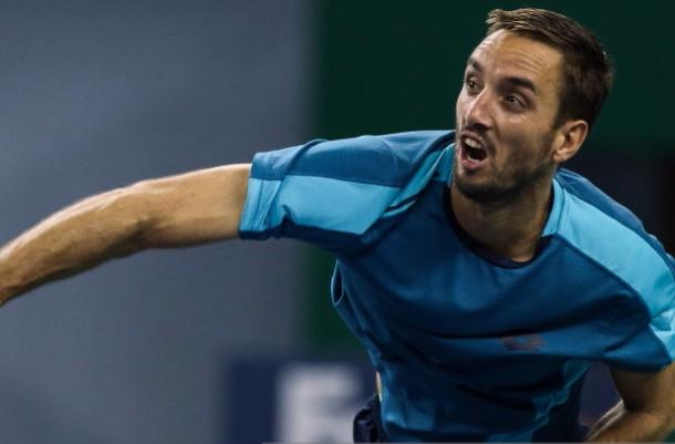 Photo Source: Yifan Ding/Getty Images-Viktor Troicki served his way to the quarterfinals.