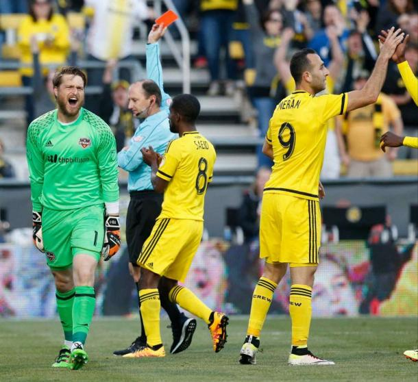 Tyler Deric is shown red after taking down Federico Higuain in the box. Photo courtesy: Barbara Perenic - TNS
