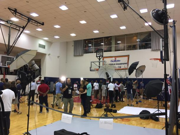 The press gathers around the practice court to take pictures and talk to players. Photo: Raj Sawhney