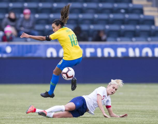 Marta wins the ball and pushes forward to earn a penalty kick for Brazil. | Photo: AP - Chris Szagola
