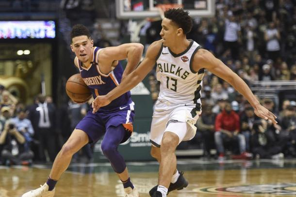 Phoenix Suns guard Devin Booker (1) is pressured by Milwaukee Bucks guard Malcolm Brogdon (13). |Benny Sieu-USA TODAY Sports|
