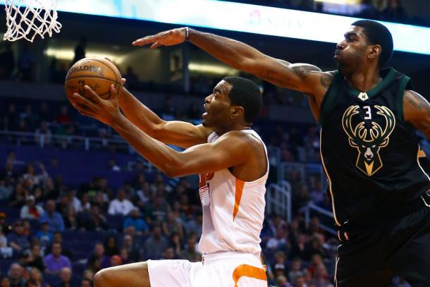 Phoenix Suns forward T.J. Warren (left) drives to the basket against the Milwaukee Bucks guard O.J. Mayo.|Credit: Mark J. Rebilas-USA TODAY Sports|