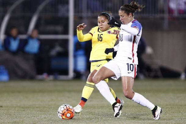 Carli Lloyd (Center) fighting to gain possession of the ball against Colombia on Wednesday at Rentschler Field. Photo provided USA TODAY Sports.