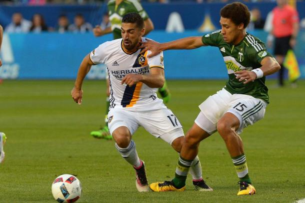 LA's Sebastian Lletget fighting to win possession of the ball against the Portland Timbers on Sunday. Photo provided USA TODAY Sports.