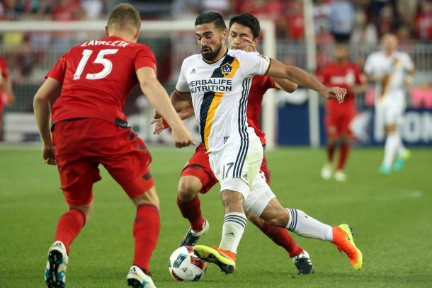 La Galaxy's Sebastian Lletget attempting to elude two Toronto FC's defenders on Saturday at BMO Field. Photo provided by USA TODAY Sports.