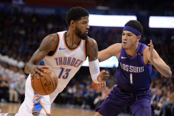 Oklahoma City Thunder forward Paul George (13) drives to the basket against Phoenix Suns guard Devin Booker (1) |Mark D. Smith-USA TODAY Sports|