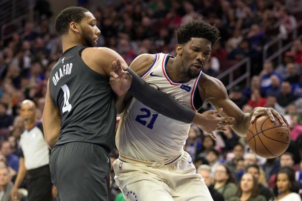 Philadelphia 76ers center Joel Embiid (21) drives against Brooklyn Nets center Jahlil Okafor (4) during the third quarter at Wells Fargo Center. |Bill Streicher-USA TODAY Sports|